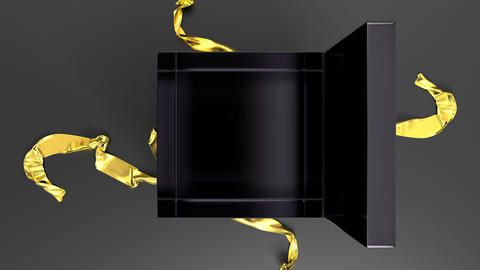 Elegant black gift box with gold ribbon opening. Top view 動畫