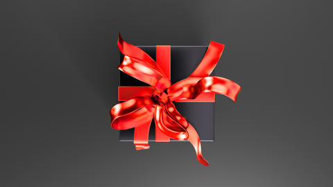 Elegant black gift box with red ribbon opening. Top view 動畫