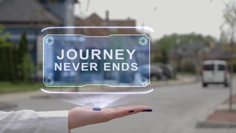 Female hand showing hologram Journey never ends Live Action