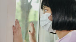 Lonely Asian girl looking outside the window, Stay home for quarantine Live Action