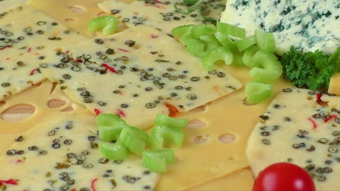 Variety of cheeses on a cutting board. Healthy food. Cold appetizer. Cold cuts ライブ動画