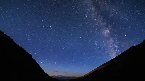 Stars over the mountains. Clouds and moonrise. Plateau Kara-Say (3.800 m.) Kyrgy Footage