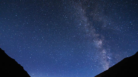 Milky Way over the mountains. Clouds and moonrise. Plateau Kara-Say (3.800 m.) K Footage