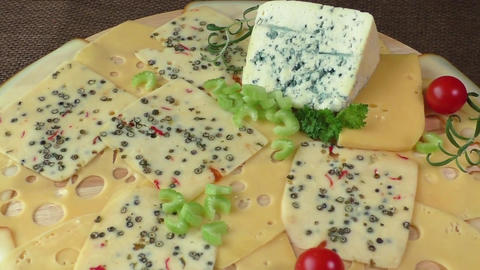 Variety of cheeses on a wooden board. Healthy food. Cold…, Live Action