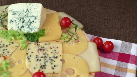 Variety of cheeses on a wooden board. Healthy food. Cold appetizer. Cold cuts Live Action