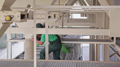 Workers Load Granular Animal Feed into a Truck Footage