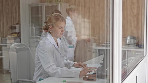 Woman is Using Desktop Computer in Office Footage