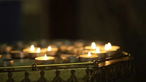Many Candle Flames Glowing in the Dark Church Footage