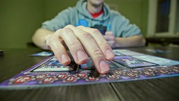 Board Game Hand Moves the Figure Footage