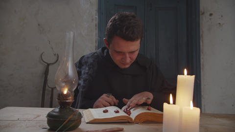 Magician foretelling future with magic book and runes Live Action