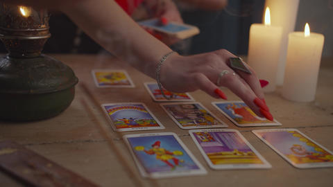 Fortuneteller tarot card reading during divination Live Action