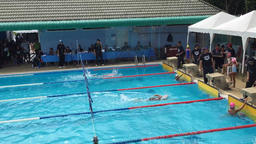 Athletes swimming competition in the pool at Pokapanitnukul school ビデオ
