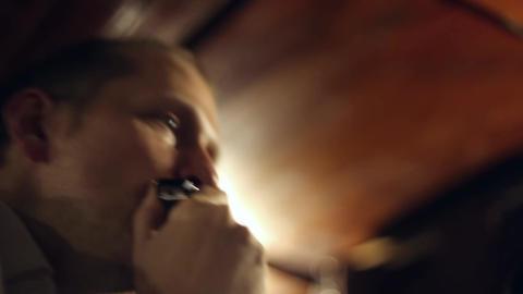 Musician plays the harmonica Footage