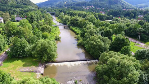 Mountain river and green riverbank from above. Ustron. Poland Footage