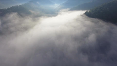 Landscape misty panorama. Fantastic dreamy sunrise on rocky mountains with view Footage
