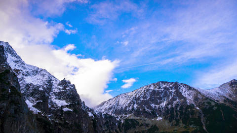 Snowy Peaks of Mountains with Clouds Footage
