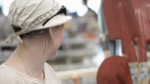 Woman In A Tool Shop