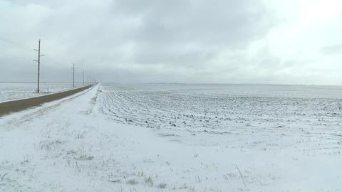 Snow Covered Roads Near Farm Fields In Rural America 2