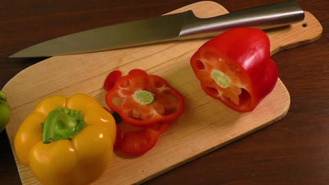 Cutting and preparing bell peppers on a cutting board Footage