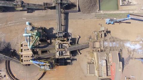 Iron raw materials recycling pile, work machines. Metal waste junkyard. Excavato Footage