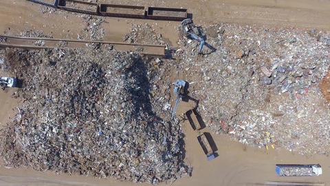 Iron raw materials recycling pile, work machines. Metal waste junkyard. Excavato Footage