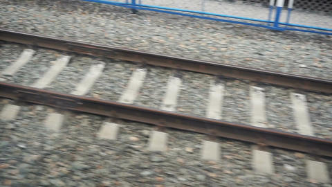 View on the rails from the window of moving train Footage