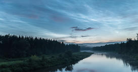 Timelapse of noctilucent clouds and sunrise over river Footage