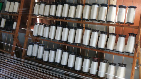 White silk thread on weaving tool, Myanmar Footage