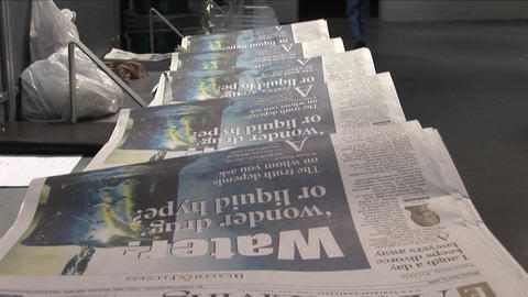 Tilt up to the Arts and Living section of newspapers in... Stock Video Footage