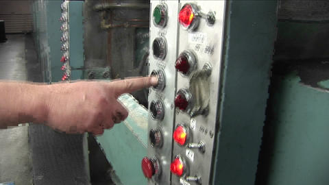 A man presses a machine to make it go faster Stock Video Footage