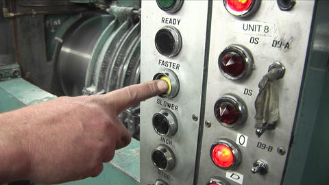A man presses a machine to make it go faster Footage