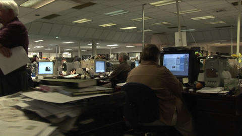 A point of view shot walking through a newsroom Stock Video Footage
