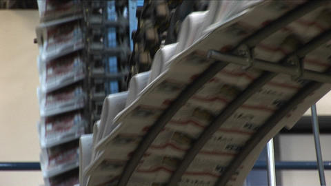 Newspapers move along an assembly line in a factory Stock Video Footage