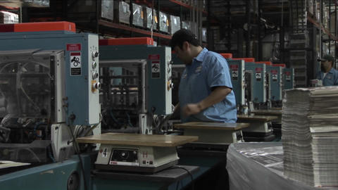 Workers in a newspaper factory maintain the printing presses Stock Video Footage