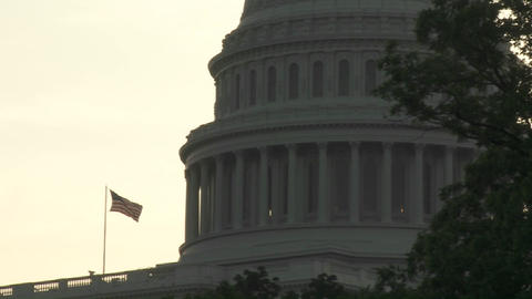 Pull back from the Capitol Building in Washington DC with an American flag visible Footage