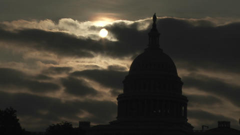 A time lapse shot of clouds moving behind the Capitol Building in Washington DC Footage