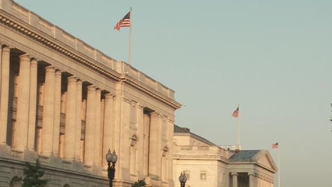 Flags fly atop buildings in Washington DC Stock Video Footage