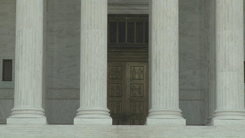A tilt up to the Supreme Court Building and the phrase... Stock Video Footage