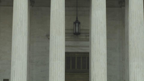 A tilt up to the Supreme Court Building and the phrase Equal Justice Under Law Footage