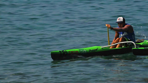 A man rows a kayak fast across the water Stock Video Footage