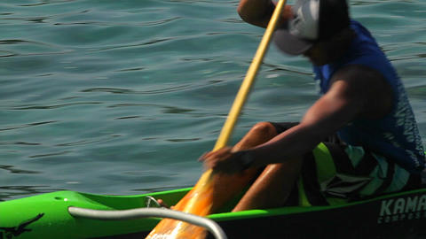 A man rows a kayak fast across the water Footage