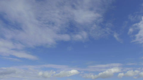 Time lapse of clouds against blue sky moving away Stock Video Footage