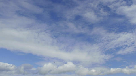 Time lapse of clouds against blue sky moving away Footage