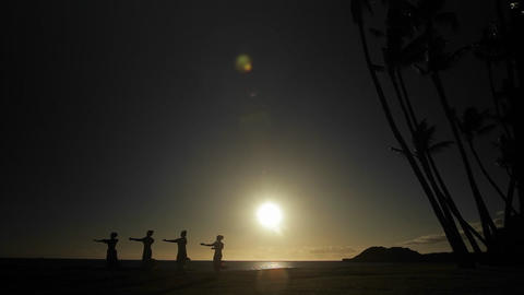 Native Hawaiian dancers perform in the distance at Stock Video Footage