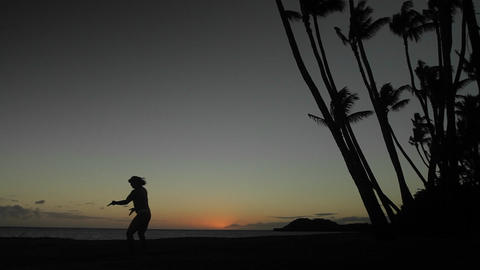 Native Hawaiian dancer performs in the distance at Stock Video Footage