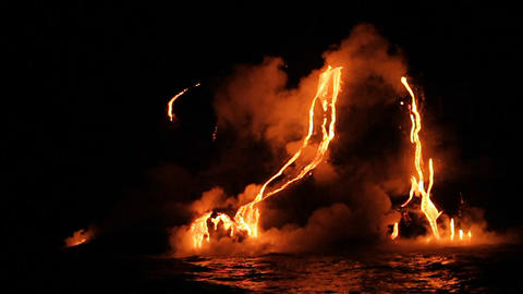 Spectacular nighttime lava flow from a volcano int Stock Video Footage