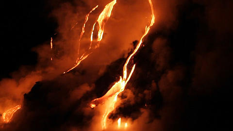 Spectacular nighttime lava flow from a volcano int Footage
