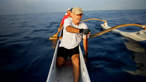 People row an outrigger canoe Footage