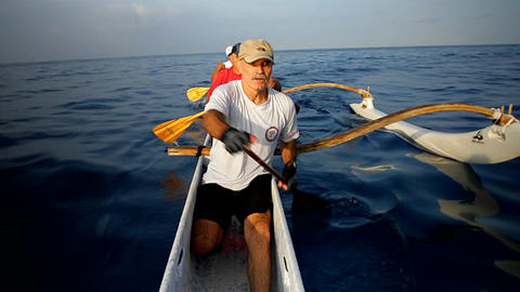 People row an outrigger canoe Stock Video Footage