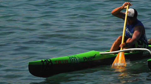 A man rows an outrigger canoe fast Stock Video Footage